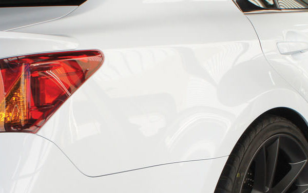 deluxe wax featured - close-up of white car after wax